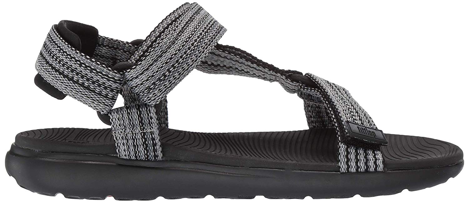 This FitFlop has visible built-in arch support and flex lines in the outsole.